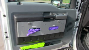Integrated glove holders in cab doors