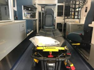 Mobility Track Seating, Strker Power Load Cot, Six-Point CPR seat, Angeled bulkhead cabinetry