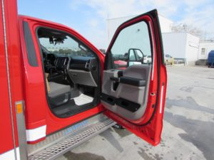 Glove holders in cab doors